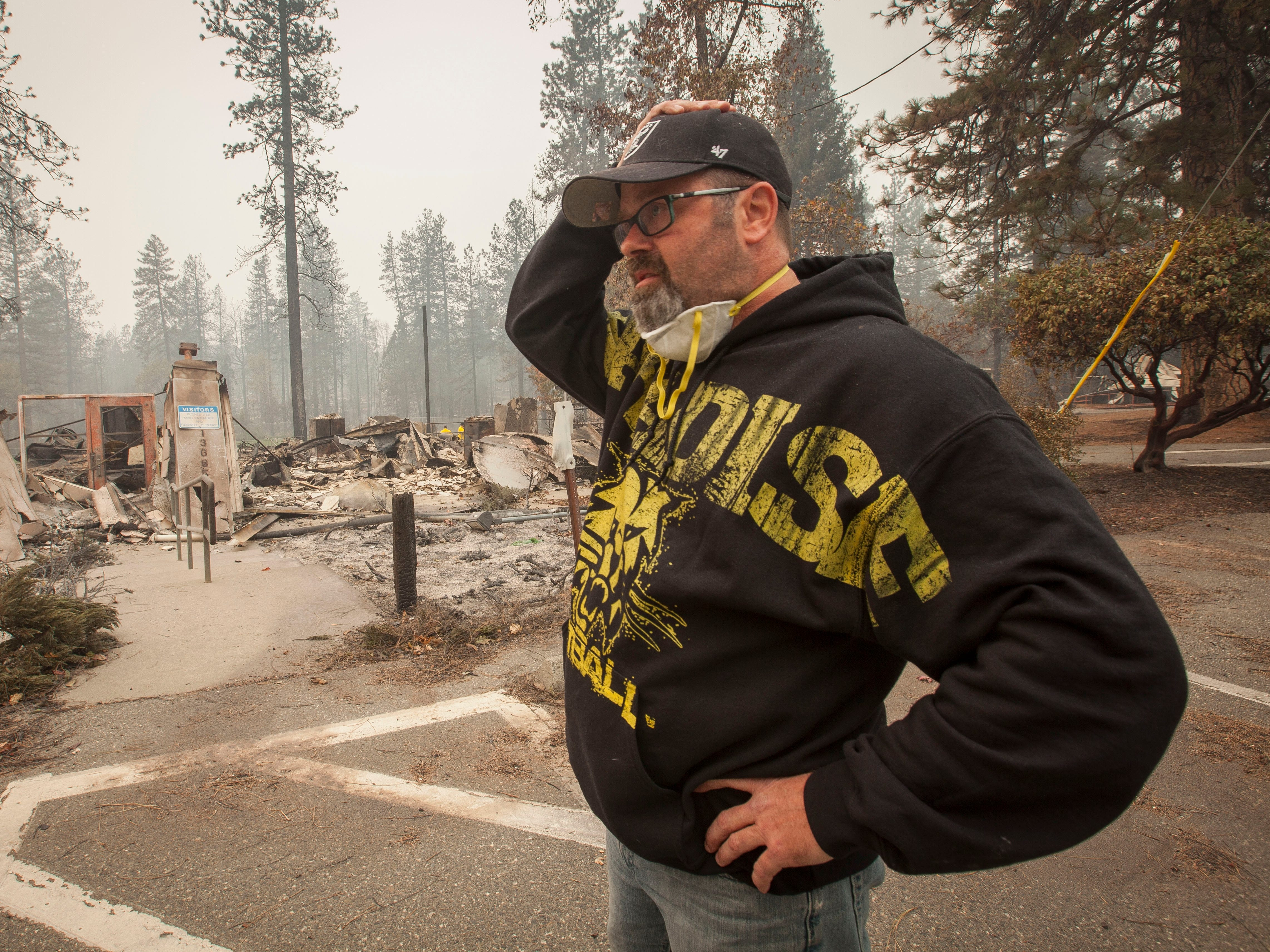 Paradise Unified School Board member Richard Gingery Jr. cannot believe the devastation as he looks over the remains of the continuation high school in Paradise, Calif., after the Camp Fire devastated the area, Nov. 15, 2018.