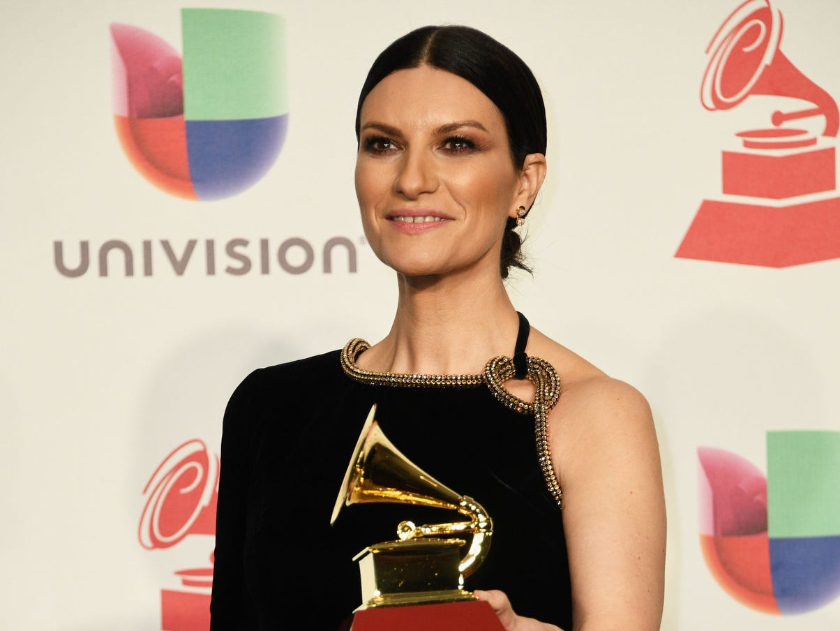 Italian singer-songwriter Laura Pausini poses with her award for Best Traditional Pop Vocal Album