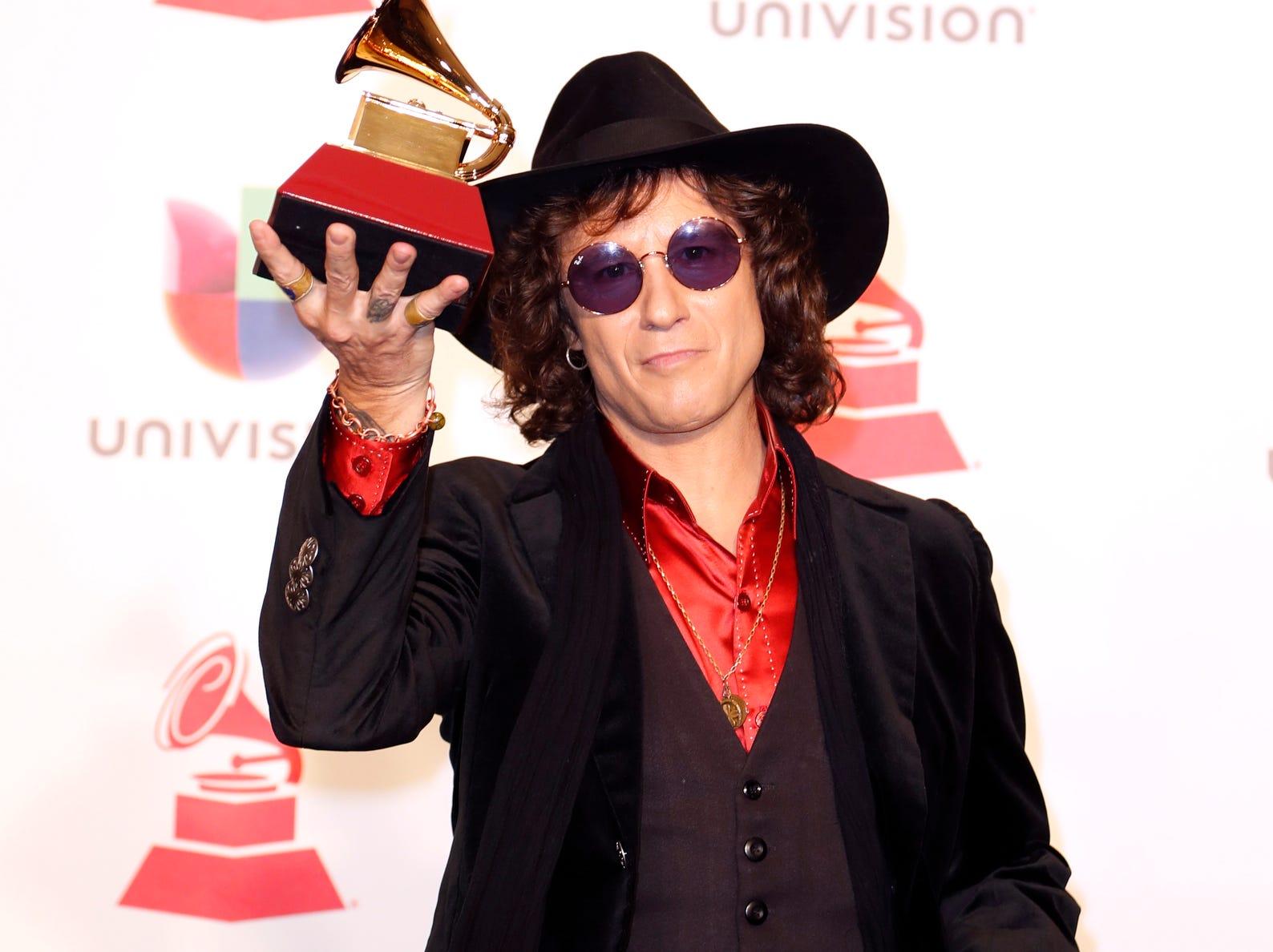 Enrique Bunbury holds the award for Best Rock Album