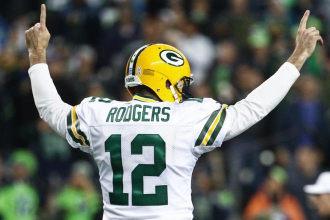 Aaron Rodgers celebrates a touchdown in the first quarter against the Seattle Seahawks at CenturyLink Field.