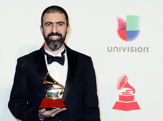 Pedro Giraudo holds the trophy for Best Tango Album.
