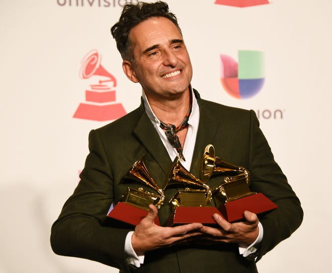 Uruguayan musician Jorge Drexler poses with his awards in the press room during the 19th Annual Latin Grammy Awards in Las Vegas, Nevada.