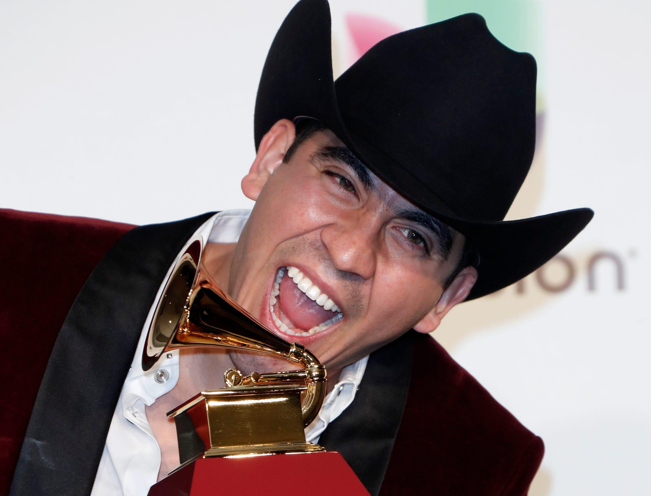 Armando Ramos of Calibre 50 with the award for Best Norteno Album.