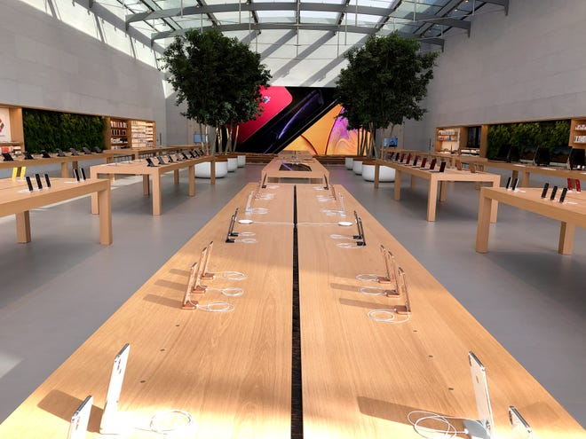 Rows of iPhones in the remodeled Apple Store in Santa Monica