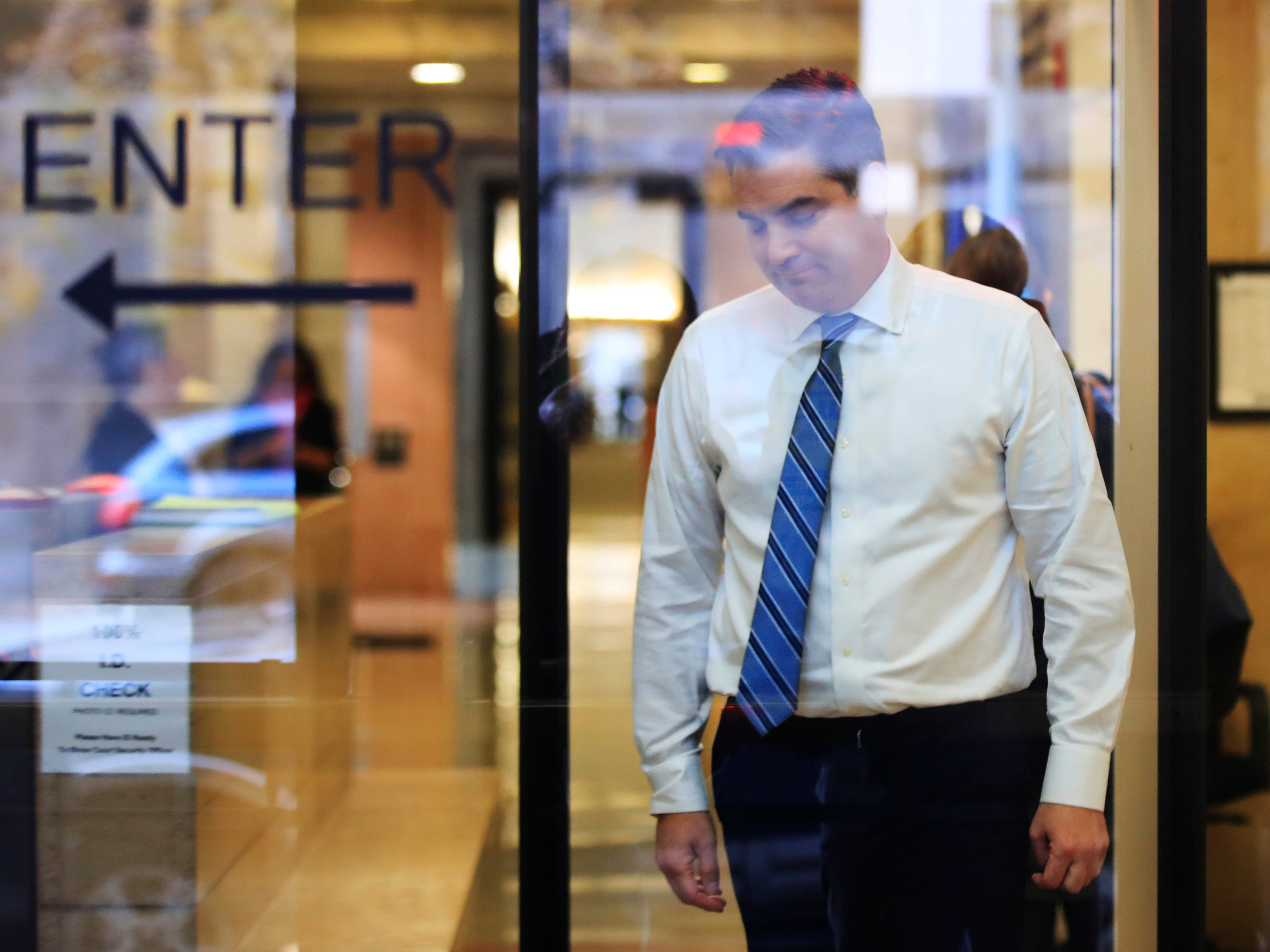 CNN's Jim Acosta goes through security check as he enters the federal court in Washington, Nov. 14, 2018, to attend a hearing in a legal challenge against President Donal Trump's administration.