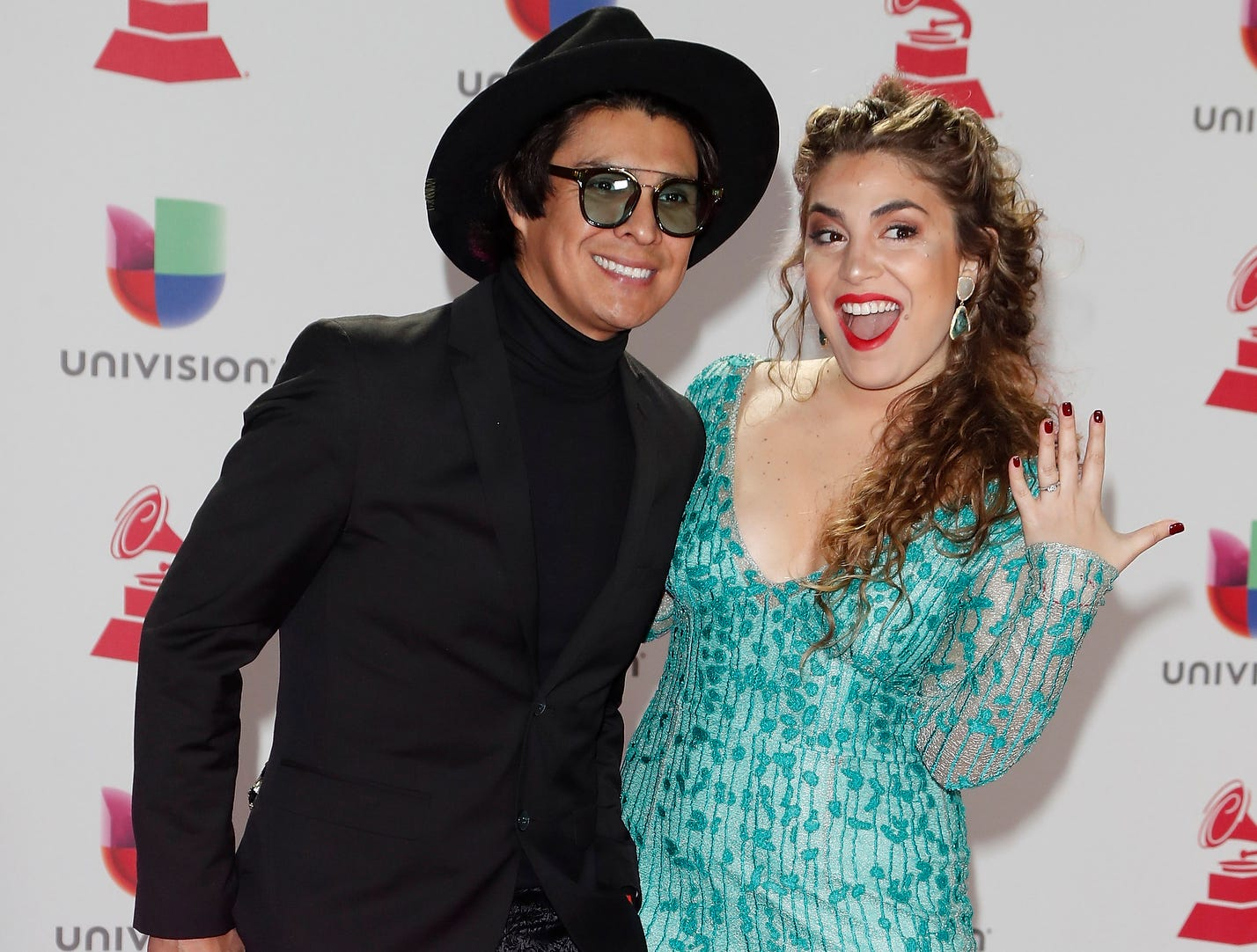 Periko and Jessi León, right, arrive for the 19th Annual Latin Grammy Awards.