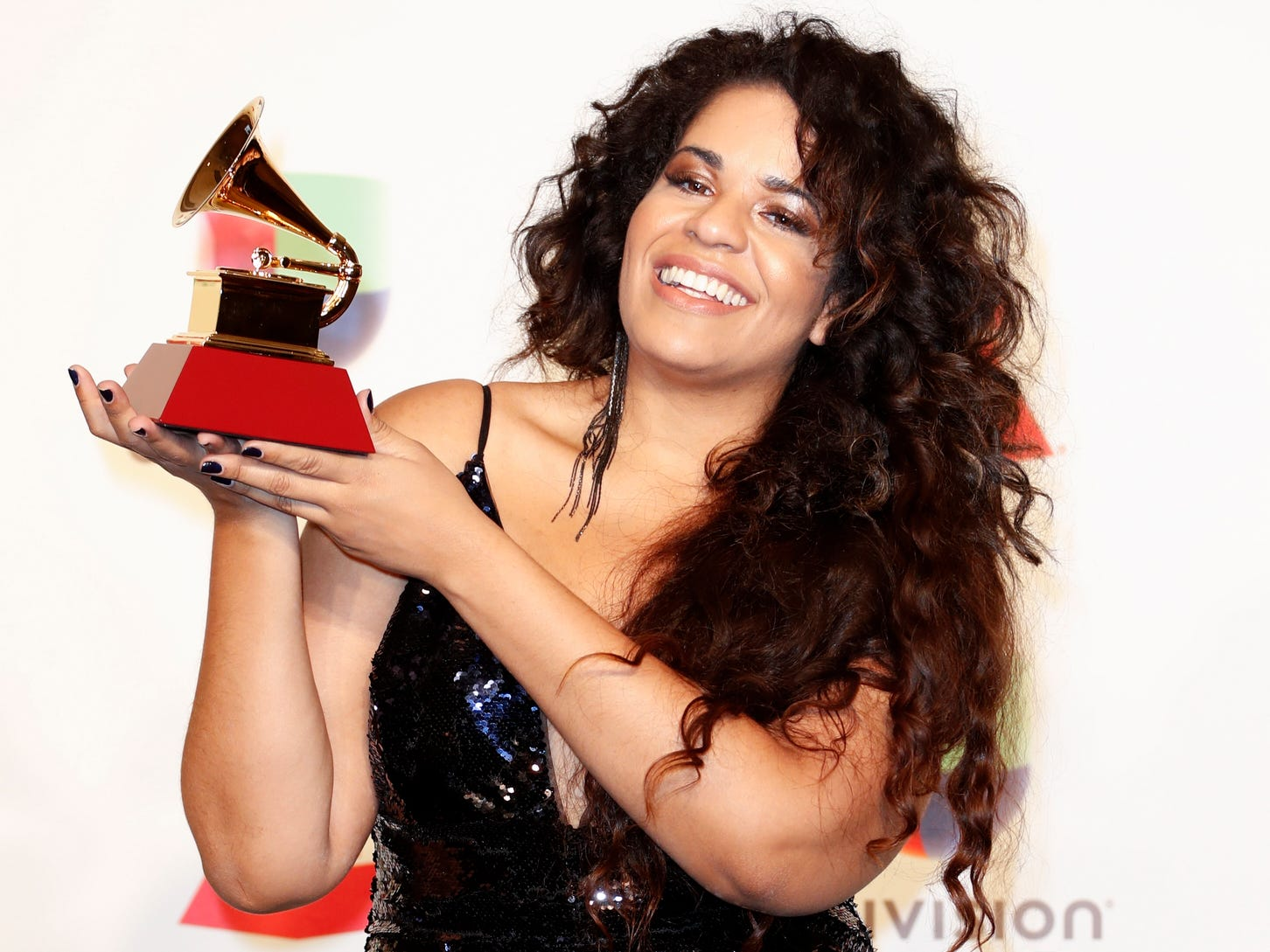 Anaadi holds the award for Best Contemporary Pop Album (Portuguese Language) in the press room during the 19th Annual Latin Grammy Awards ceremony at the MGM Grand Garden Arena in Las Vegas.