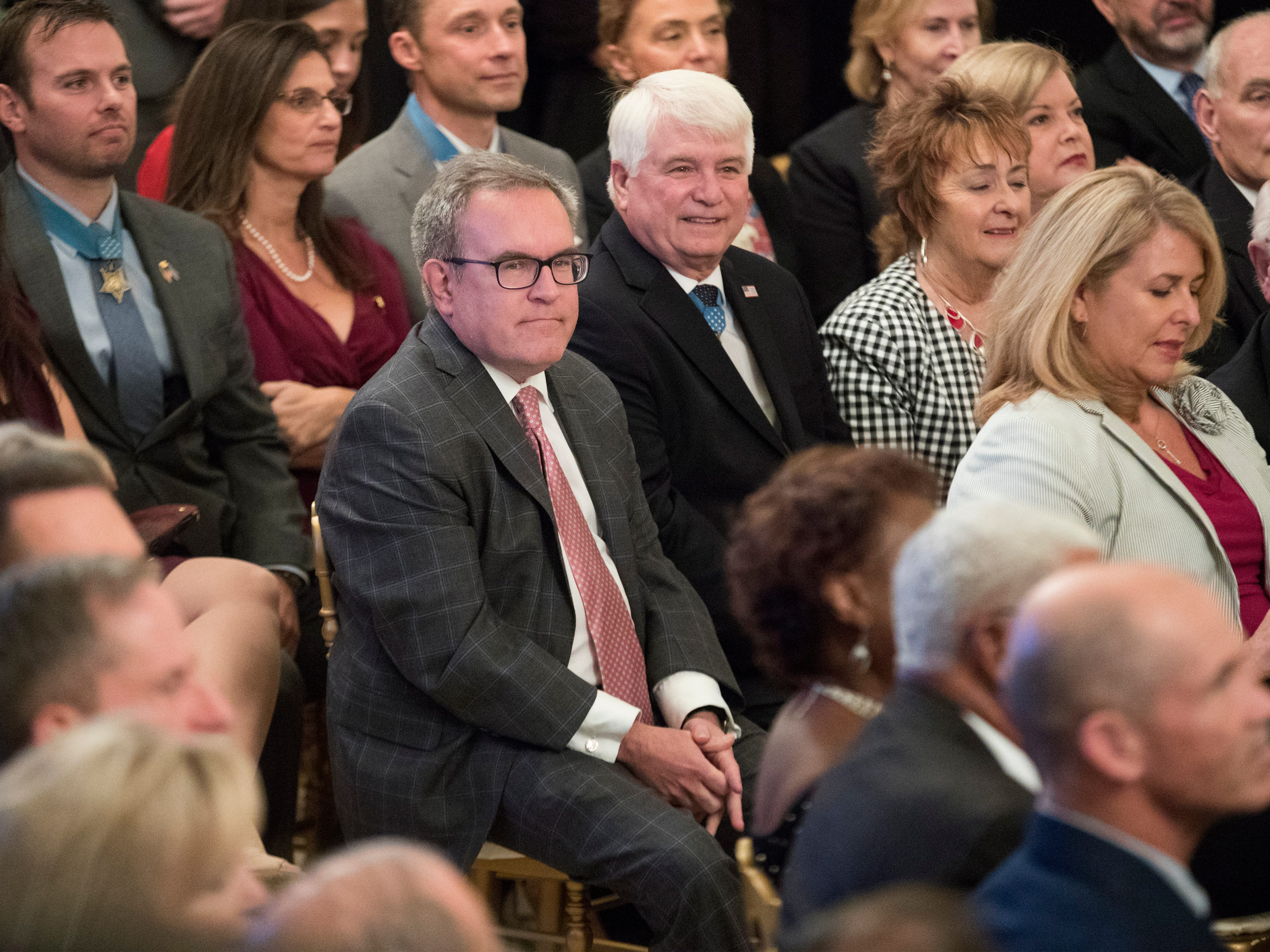 Acting Administrator of the US Environmental Protection Agency (EPA) Andrew Wheeler listens to President Donald J. Trump deliver remarks during a reception for the Congressional Medal of Honor Society, in the East Room of the White House in Washington, DC, Sept. 12,  2018.