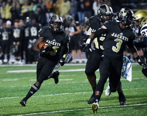 T.L. Hanna's Isaiah Norris (23) and the Yellow Jackets host Northwestern in the second round of the Class AAAAA high school football playoffs