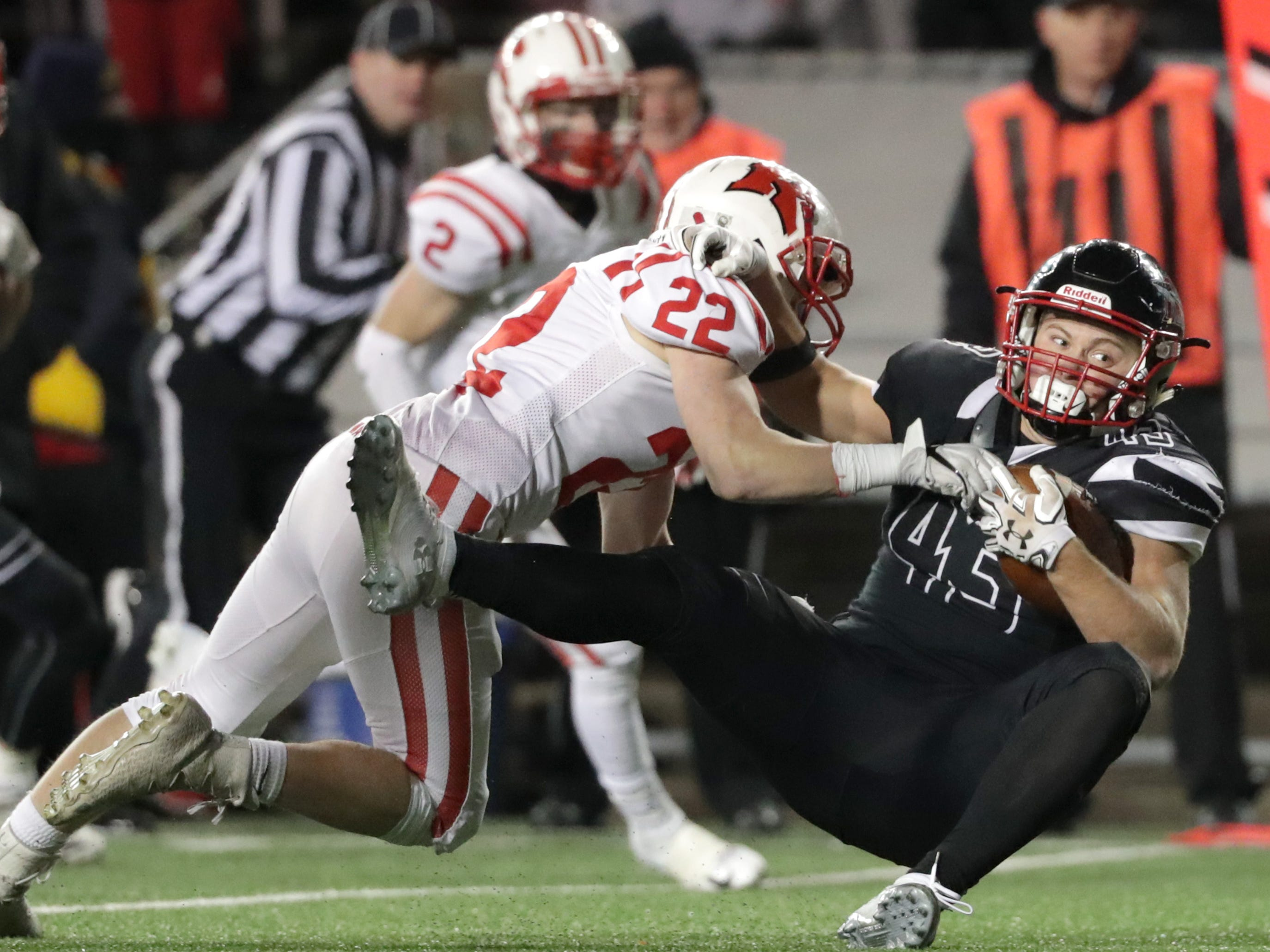 Kimberly High School's #22 Briar Barglind tackles Muskego High School's #45 Mitch Borkovec during the WIAA Division 1 state championship football game on Friday, November 16, 2018, at Camp Randall in Madison, Wis.