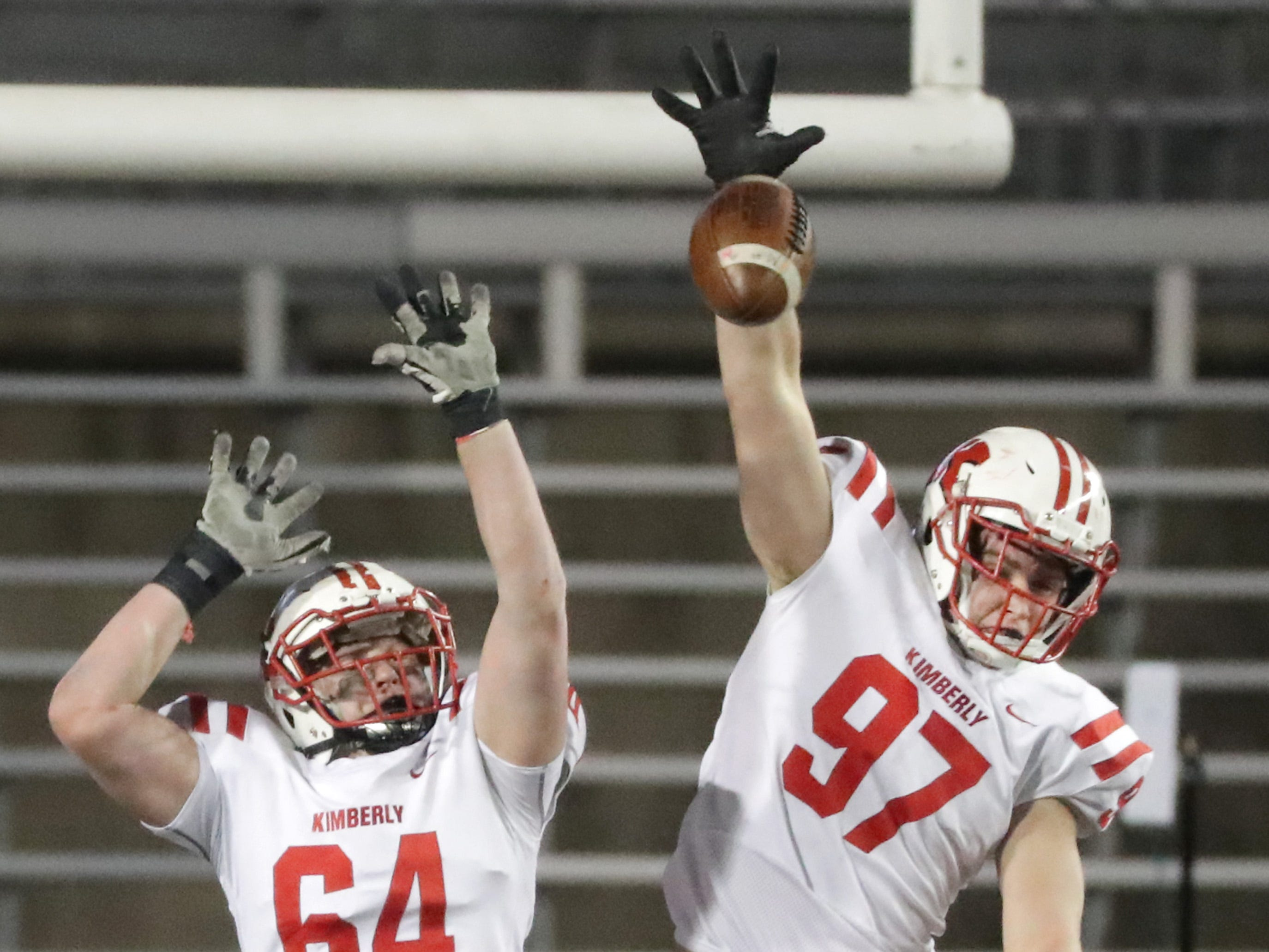 Kimberly High School's #64 Trevor Gardner and #97 Logan Wilson against Muskego High School during the WIAA Division 1 state championship football game on Friday, November 16, 2018, at Camp Randall in Madison, Wis.