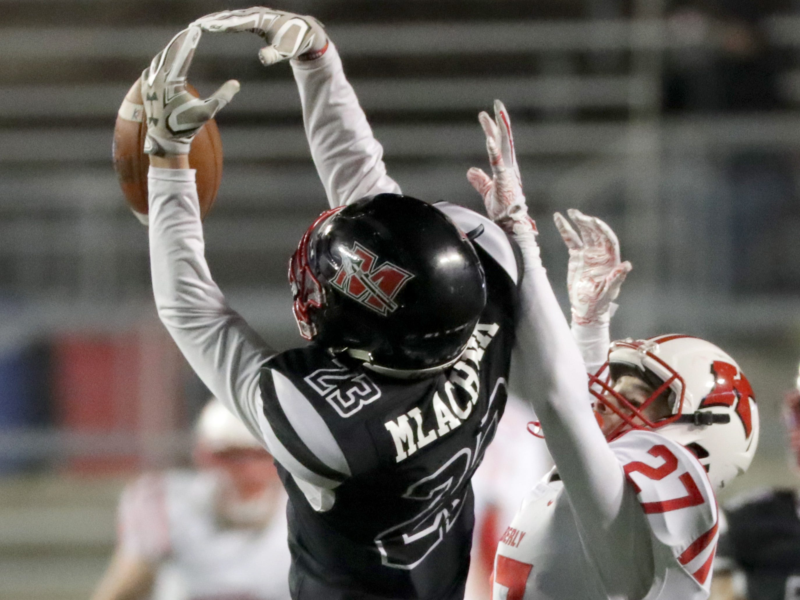 Kimberly High School's #27 Trey Tennessen breaks up a pass intended for Muskego High School's #23 Joseph Mlachnik during the WIAA Division 1 state championship football game on Friday, November 16, 2018, at Camp Randall in Madison, Wis.