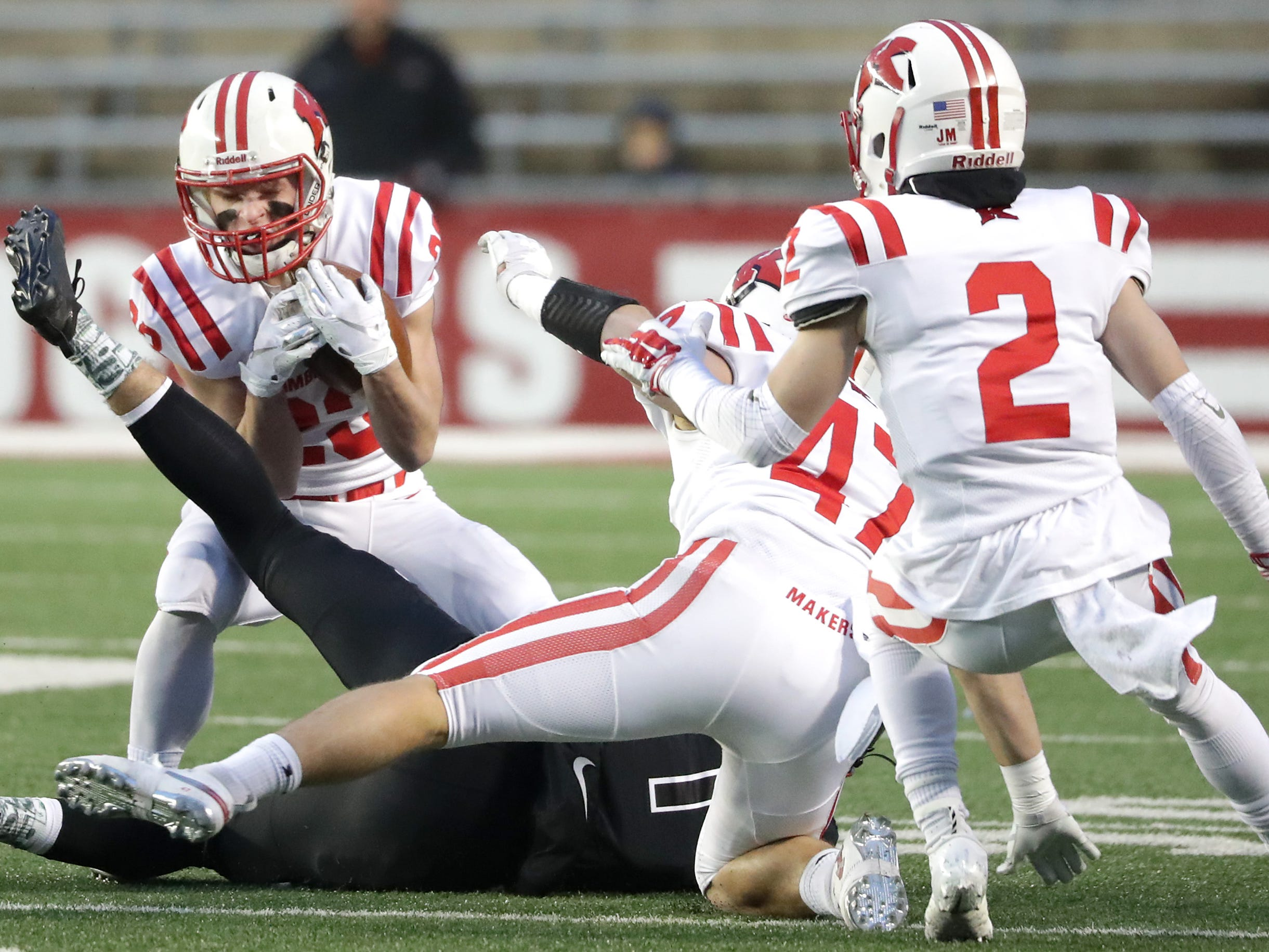 Kimberly High School's #23 Brady McConnell intercepts a pass against Muskego High School during the WIAA Division 1 state championship football game on Friday, November 16, 2018, at Camp Randall in Madison, Wis.