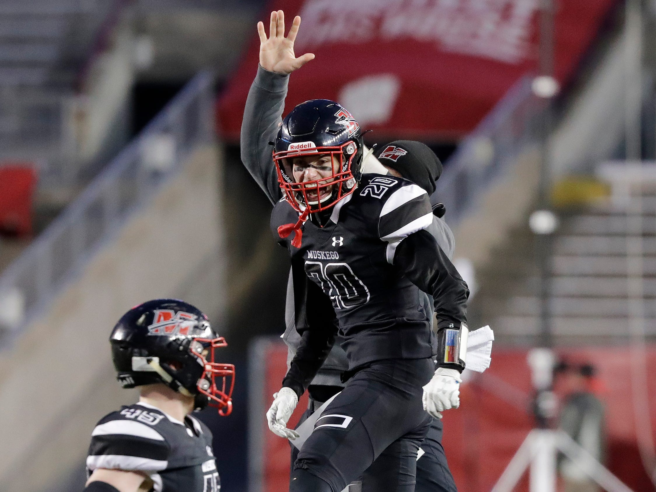 Muskego's Sam Chovanec (20) celebrates after an interception against Kimberly in the WIAA Division 1 championship game at Camp Randall Stadium on Friday, November 16, 2018 in Madison, Wis.