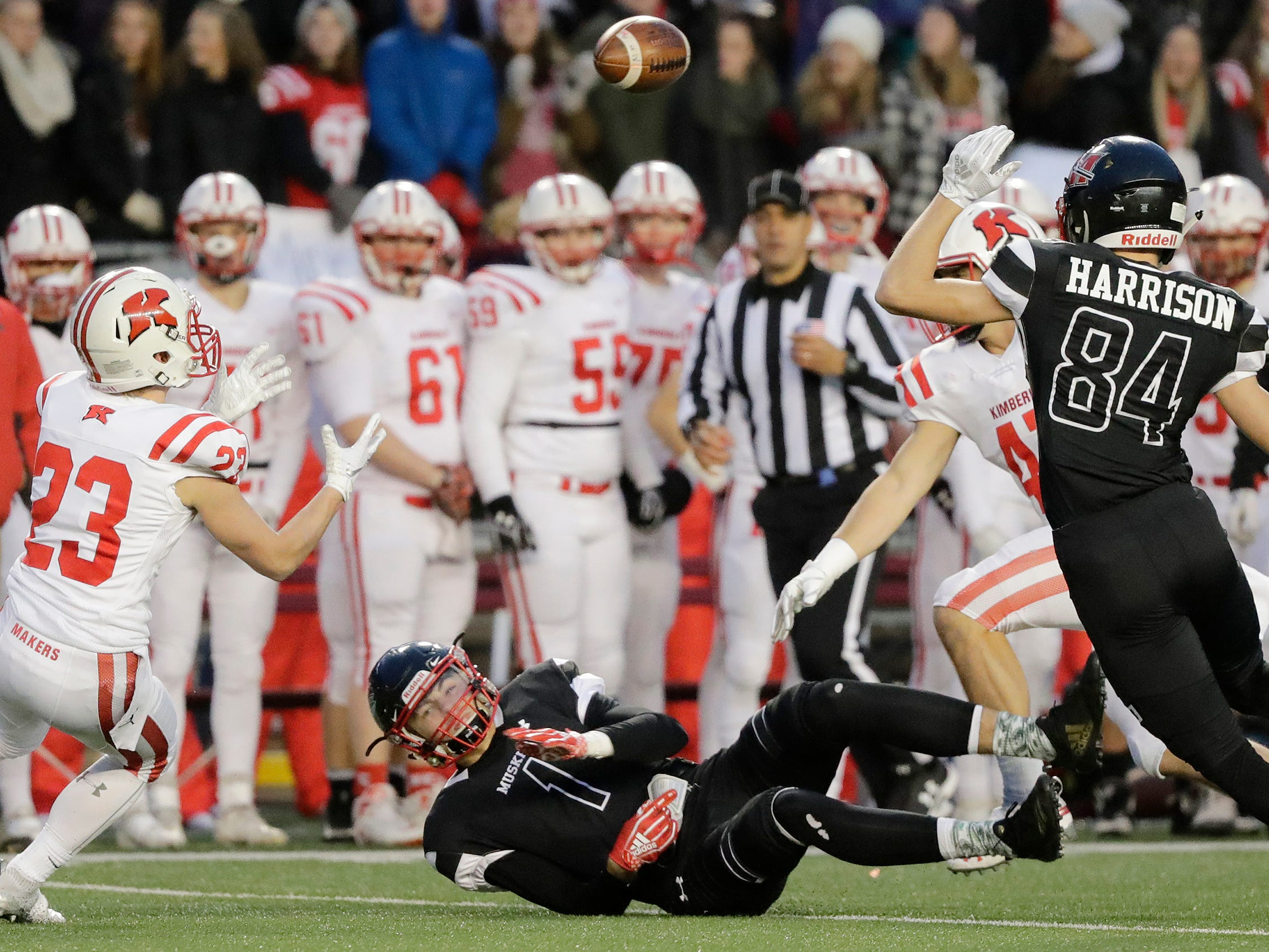 Kimberly's Zach Olson (23) intercepts a pass against Muskego in the WIAA Division 1 championship game at Camp Randall Stadium on Friday, November 16, 2018 in Madison, Wis.