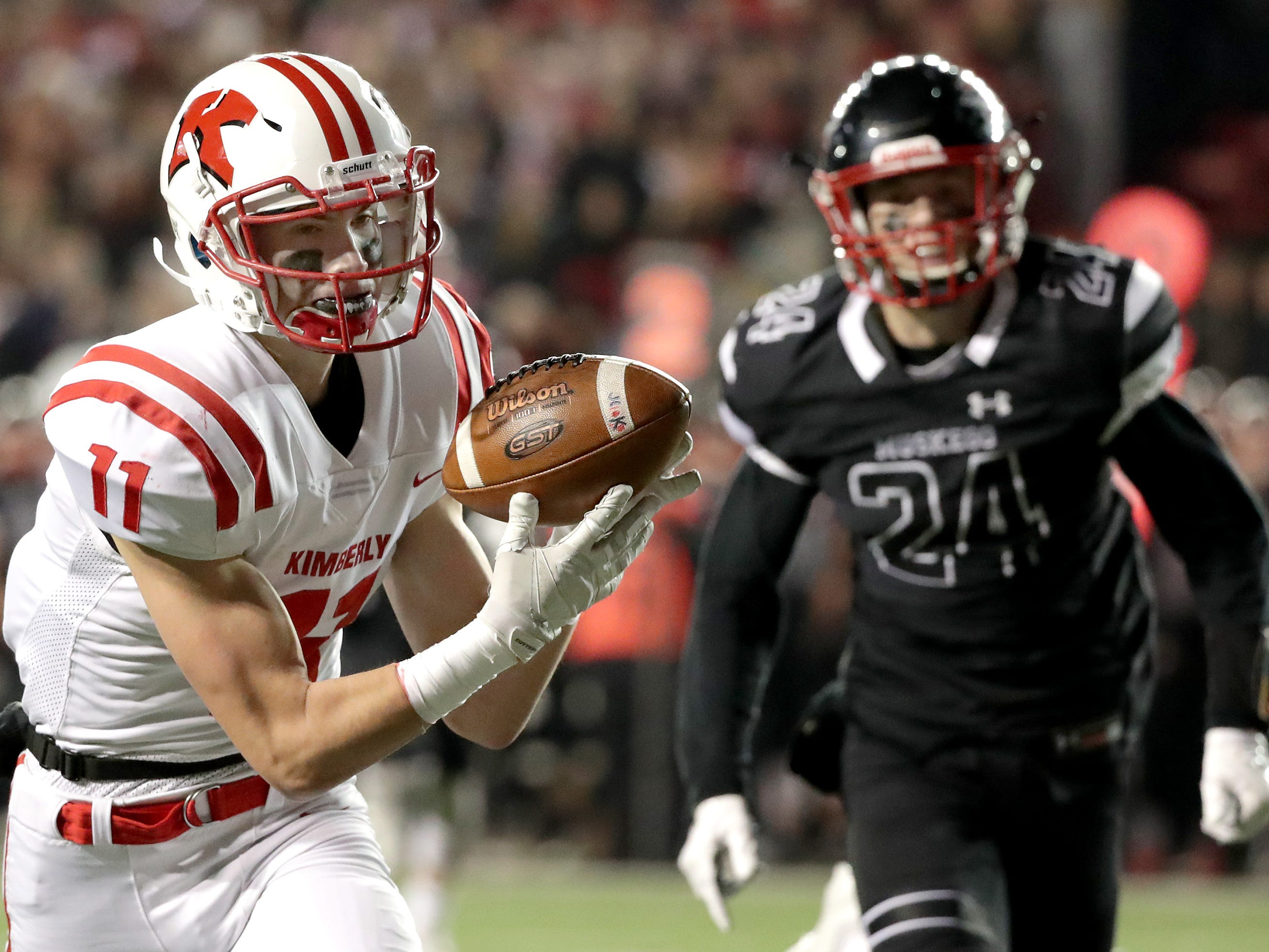 Kimberly High School's #11 Conner Wnek catches a touch down pass against Muskego High School during the WIAA Division 1 state championship football game on Friday, November 16, 2018, at Camp Randall in Madison, Wis.