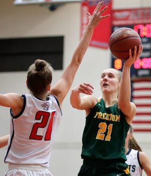Freedom's Callie Genke (right) tries to put up a shot over Appleton East's Emily La Chapell on Nov. 16. The Irish are ranked No.  2 in the Divisions 3-5 local girls basketball rankings.