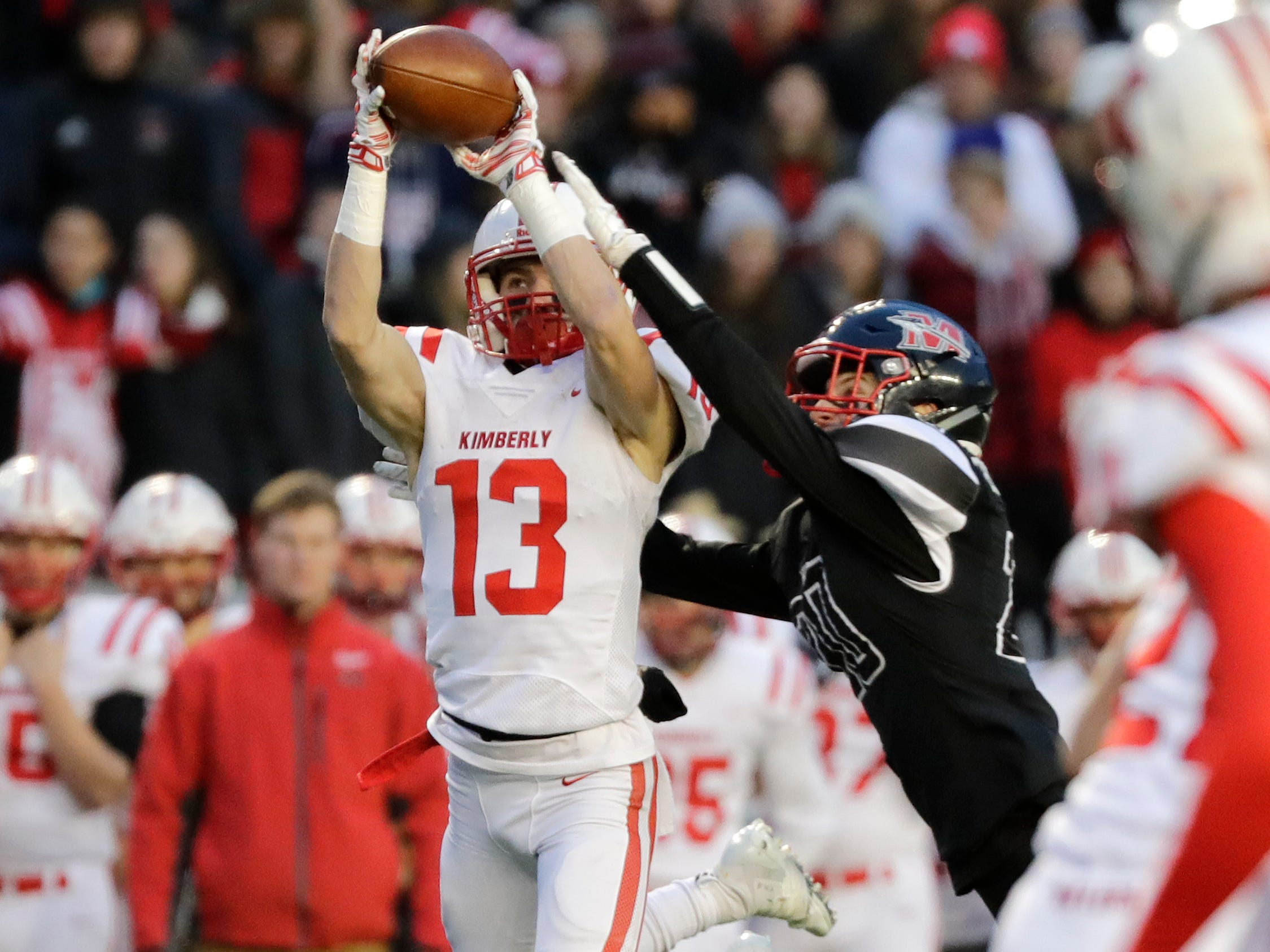 Kimberly's Zach Lechnir (13) catches a pass against Muskego in the WIAA Division 1 championship game at Camp Randall Stadium on Friday, November 16, 2018 in Madison, Wis.