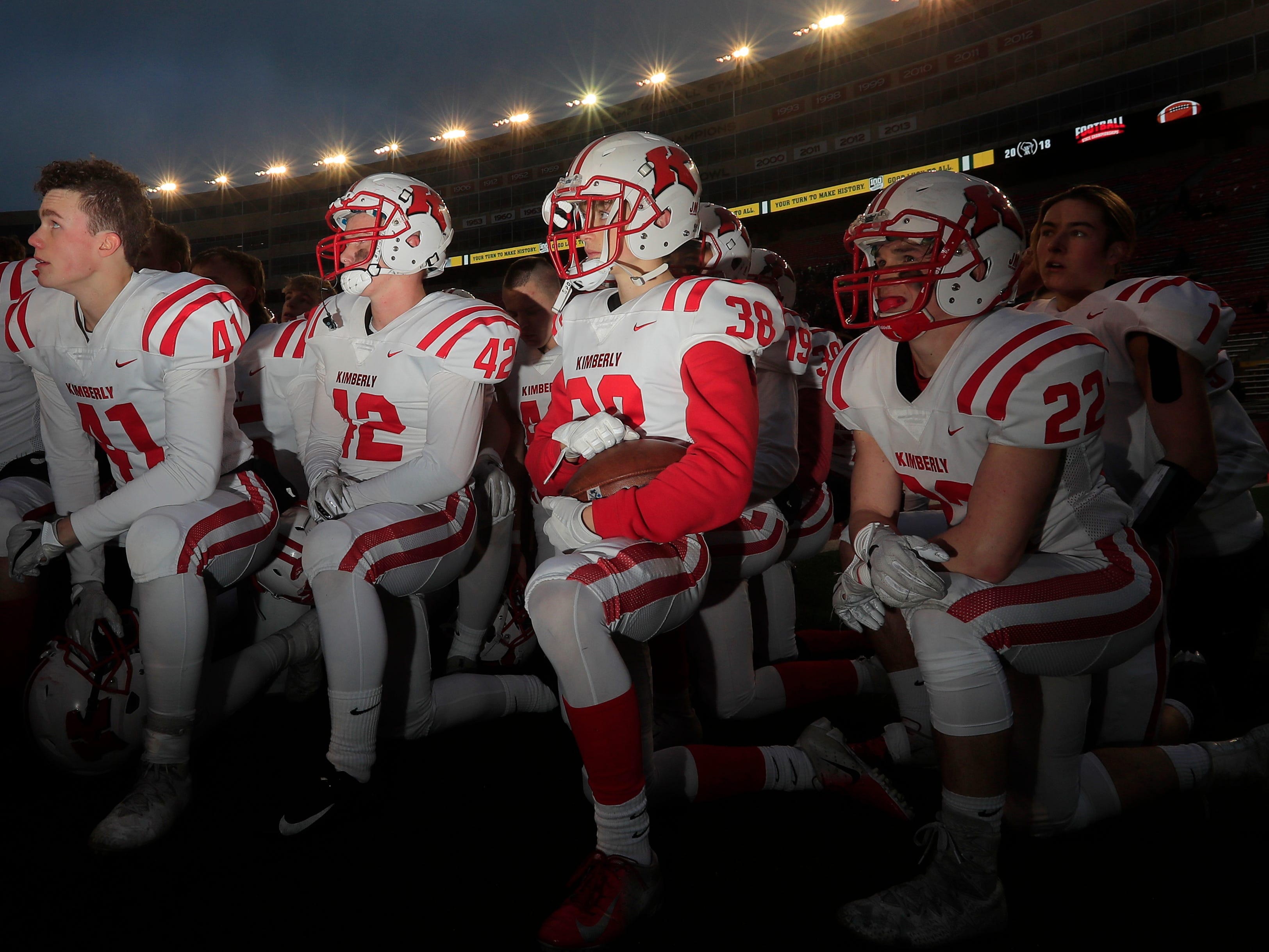 Kimberly players huddle before the WIAA Division 1 championship game at Camp Randall Stadium on Friday, November 16, 2018 in Madison, Wis.