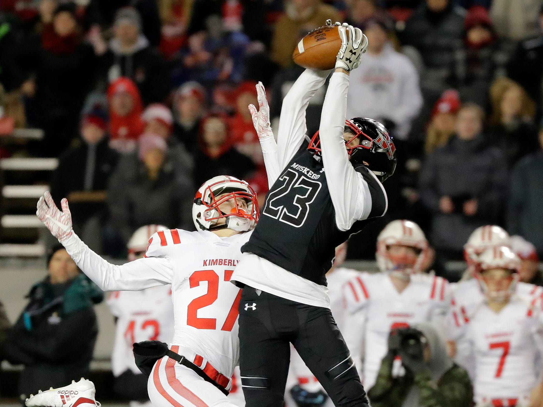Muskego's Joseph Mlachnik (23) breaks up a pass intended for Kimberly's Trey Tennessen (27) in the WIAA Division 1 championship game at Camp Randall Stadium on Friday, November 16, 2018 in Madison, Wis.