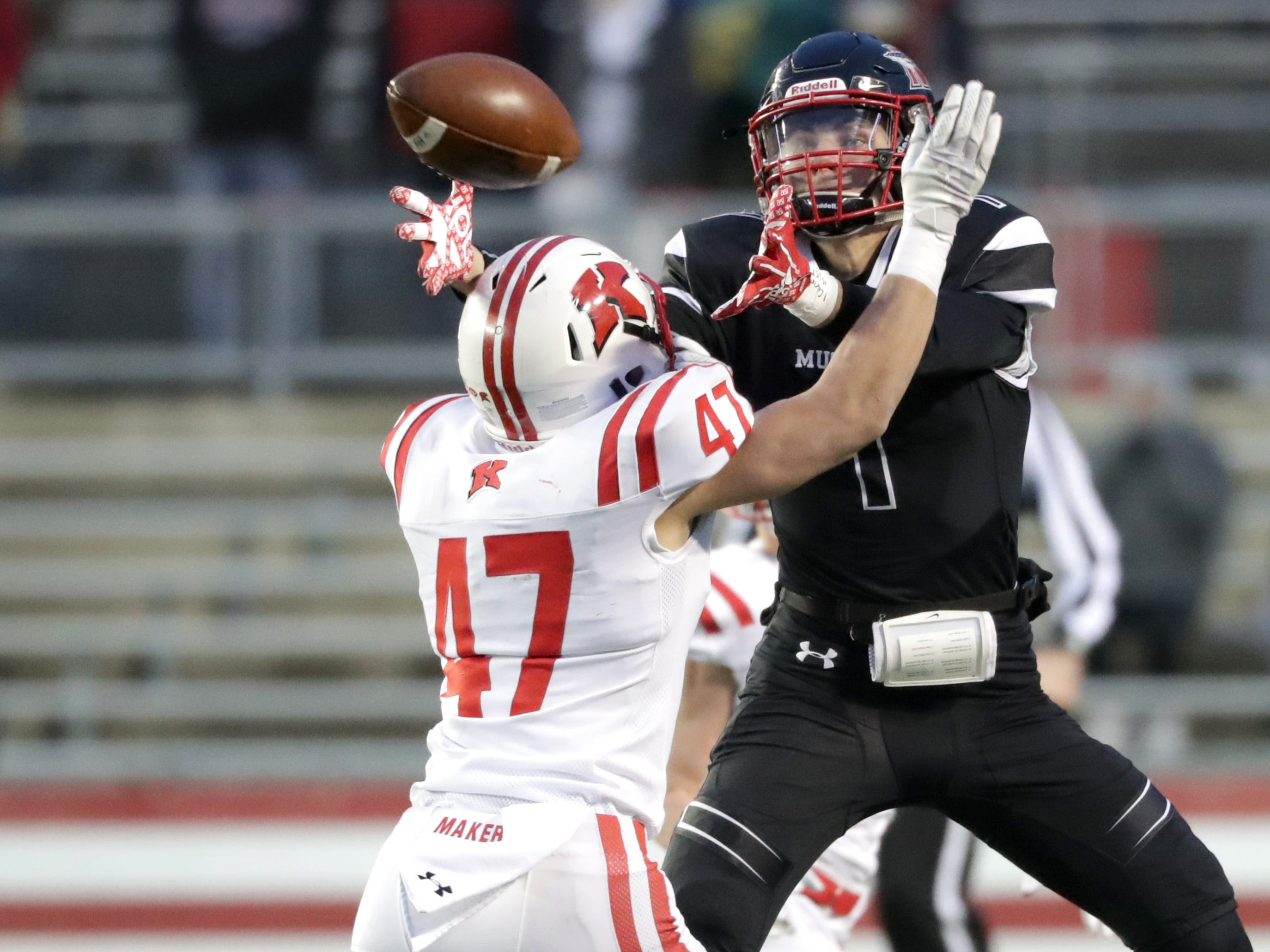 Kimberly High School's #47 Tristan Argall breaks up a pass intended for Muskego High School's #1 Steven Jamroziak during the WIAA Division 1 state championship football game on Friday, November 16, 2018, at Camp Randall in Madison, Wis.