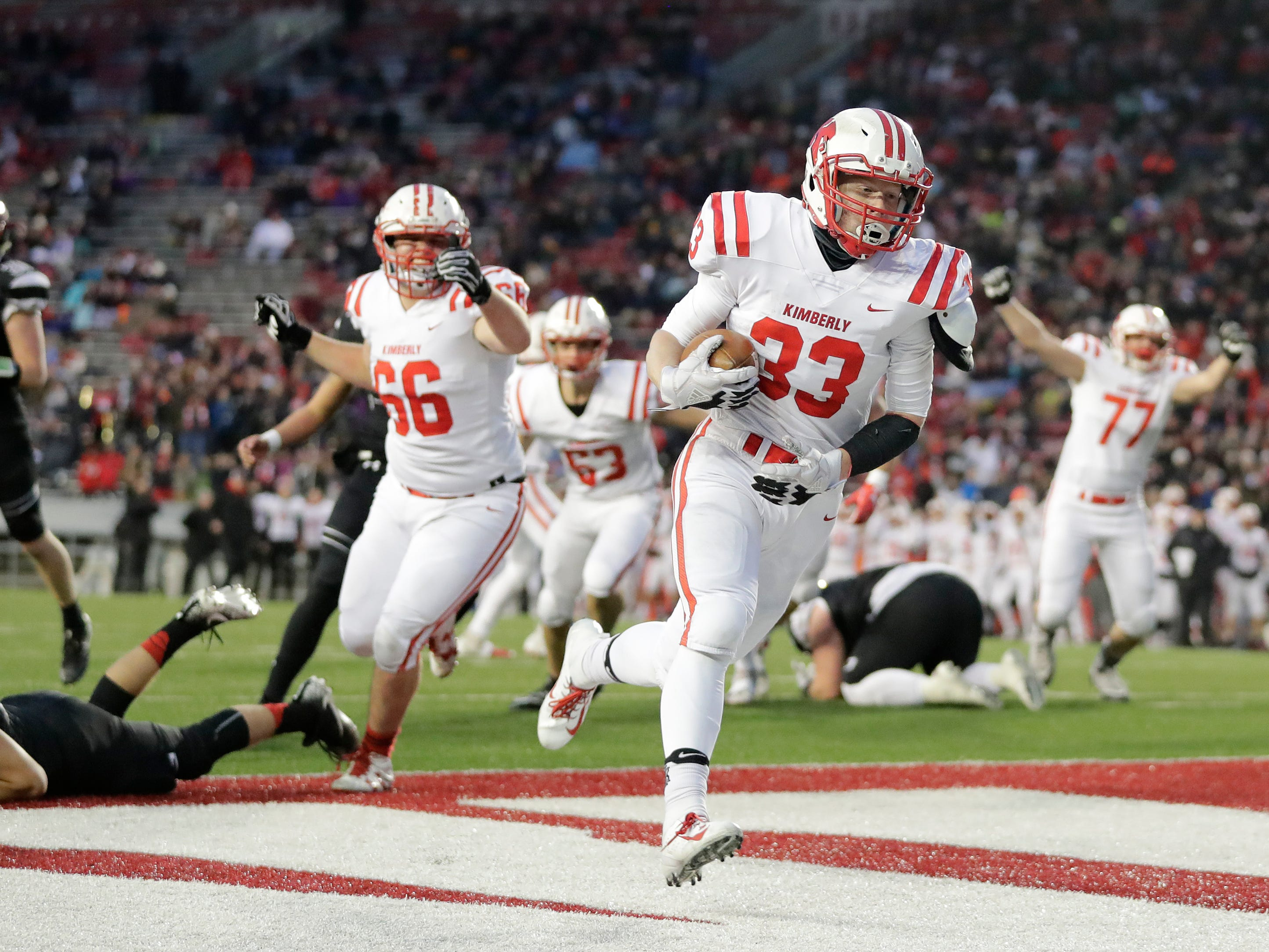 Kimberly's Caleb Frazer (33) rushes for a touchdown against Muskego in the WIAA Division 1 championship game at Camp Randall Stadium on Friday, November 16, 2018 in Madison, Wis.