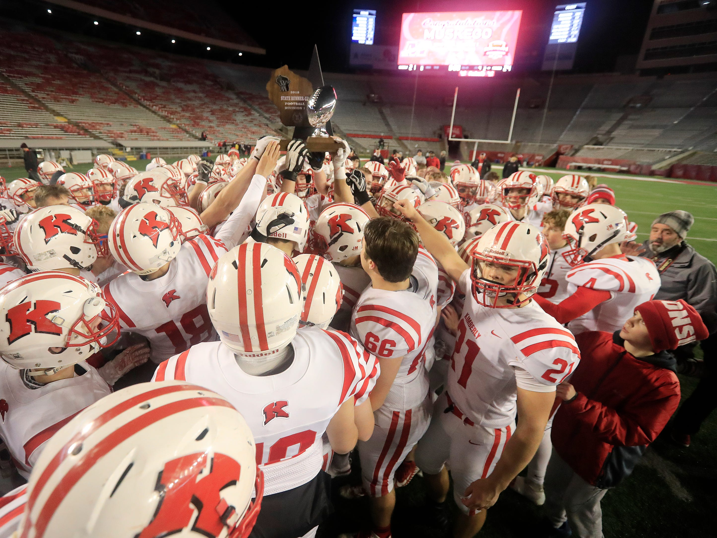 Kimberly players hold up the runners up trophy after losing to Muskego in the WIAA Division 1 championship game at Camp Randall Stadium on Friday, November 16, 2018 in Madison, Wis.
