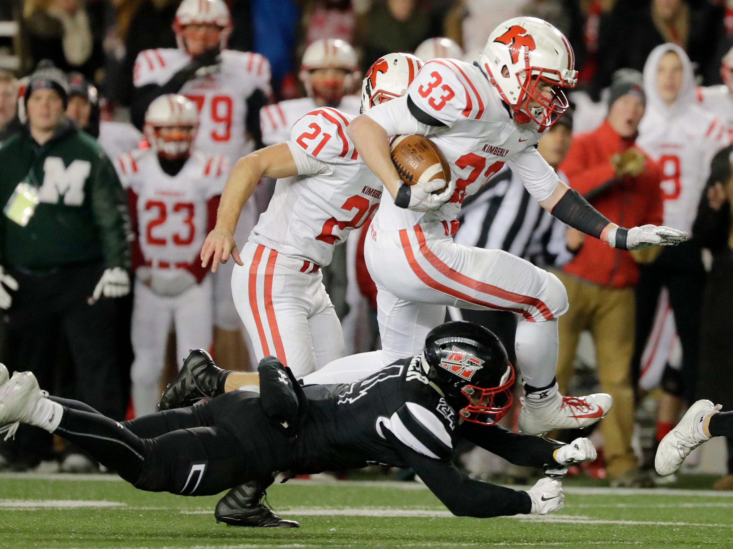 Kimberly's Caleb Frazer (33) rushes against Muskego in the WIAA Division 1 championship game at Camp Randall Stadium on Friday, November 16, 2018 in Madison, Wis.