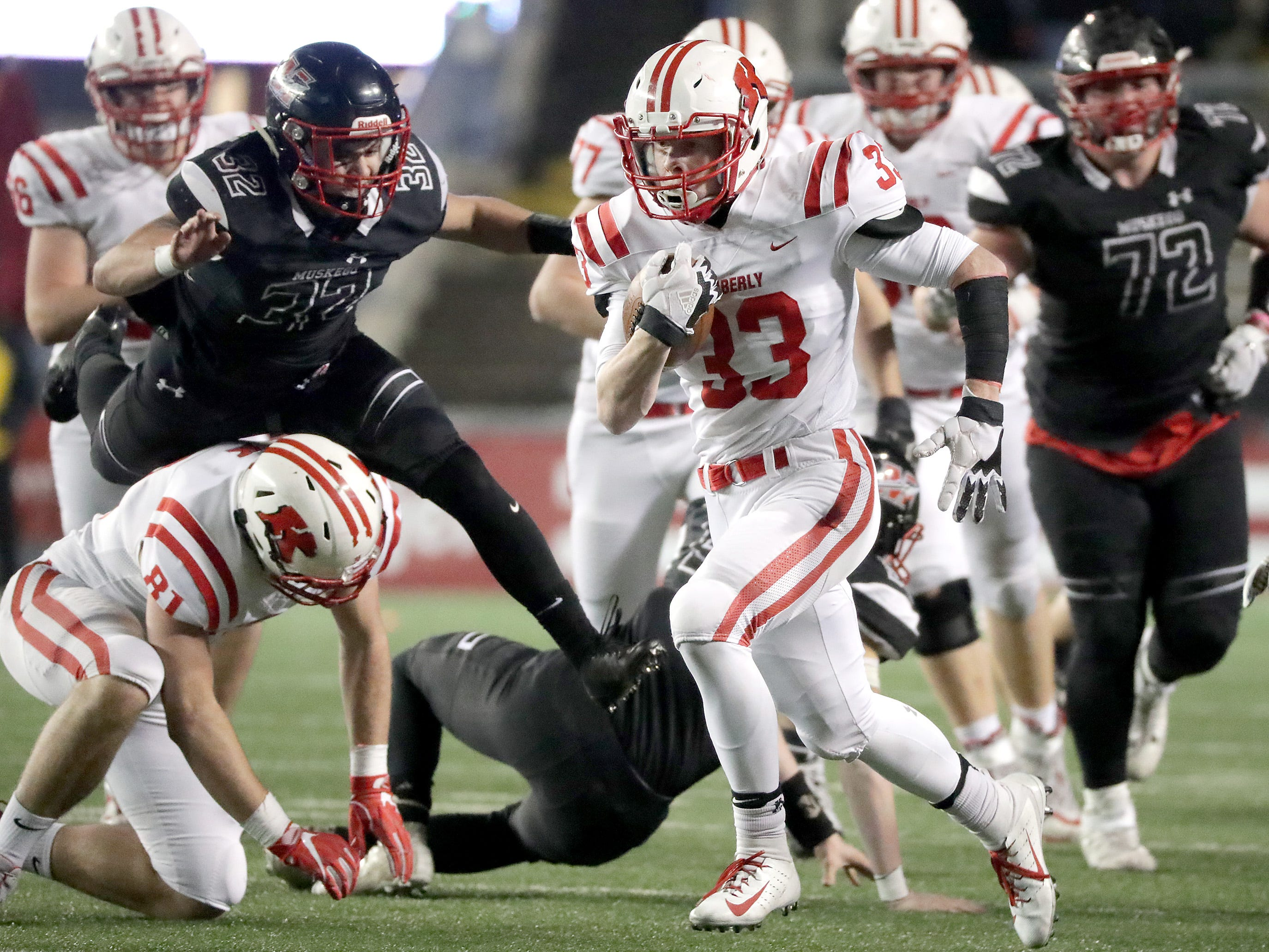 Kimberly High School's #33 Caleb Frazer rushes against Muskego High School during the WIAA Division 1 state championship football game on Friday, November 16, 2018, at Camp Randall in Madison, Wis.