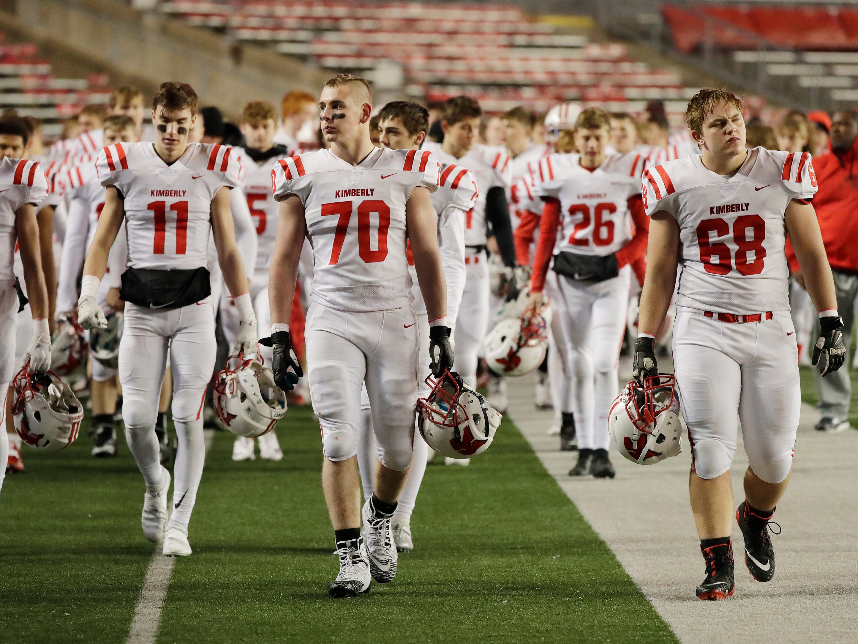 Kimberly player leave the field after losing to Muskego in the WIAA Division 1 championship game at Camp Randall Stadium on Friday, November 16, 2018 in Madison, Wis.