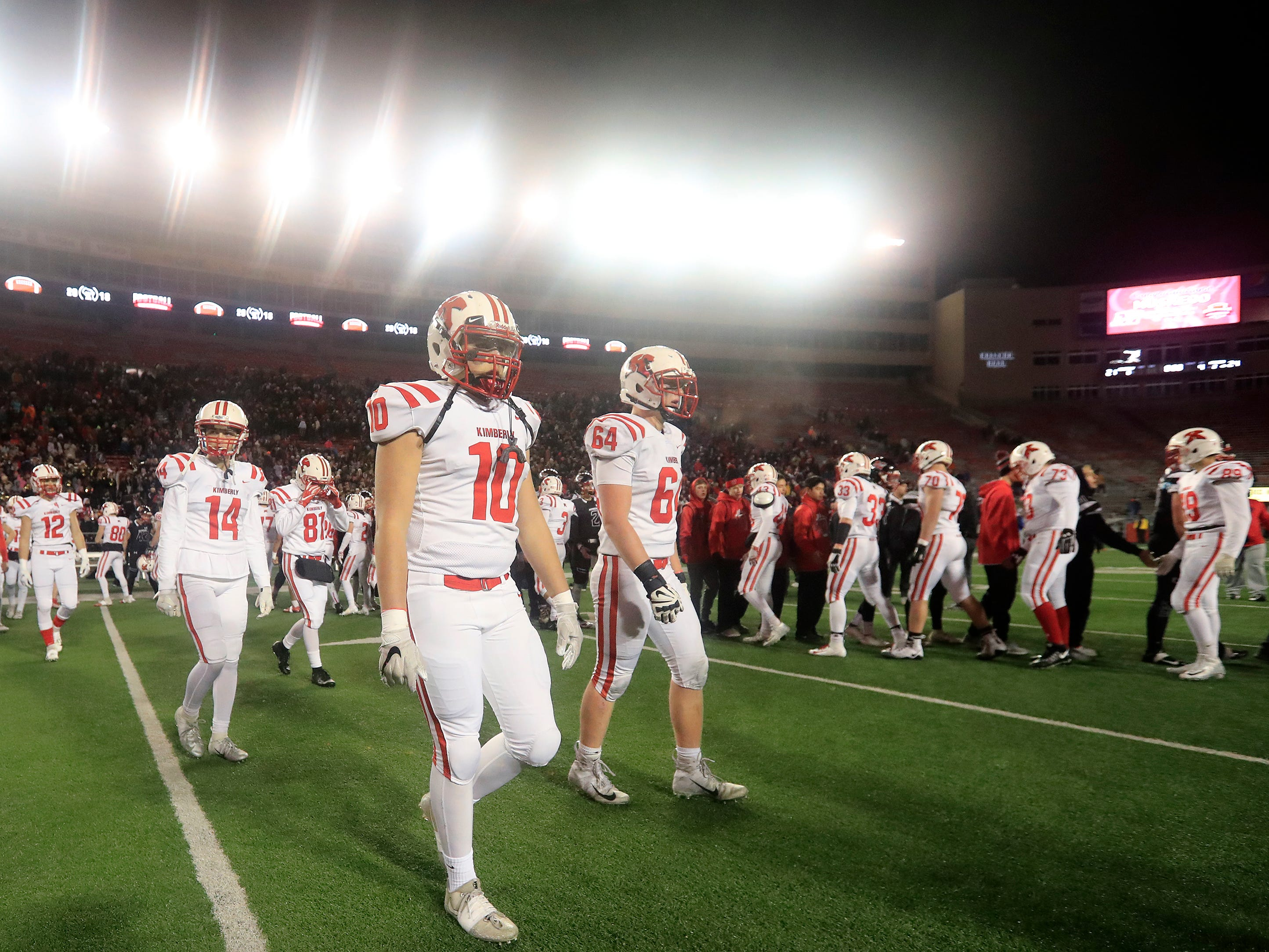 Kimberly's Gavin McBrair (10) walks off the field after the Papermakers lost to Muskego in the WIAA Division 1 championship game at Camp Randall Stadium on Friday, November 16, 2018 in Madison, Wis.