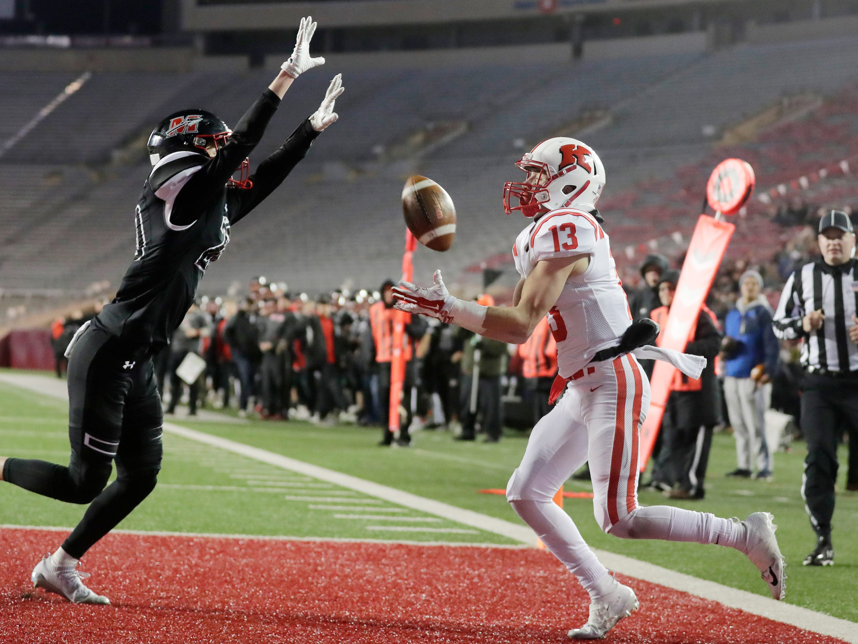 Kimberly's Zach Lechnir (13) bobbles a pass in the end zone at the end of the first half against Muskego in the WIAA Division 1 championship game at Camp Randall Stadium on Friday, November 16, 2018 in Madison, Wis.