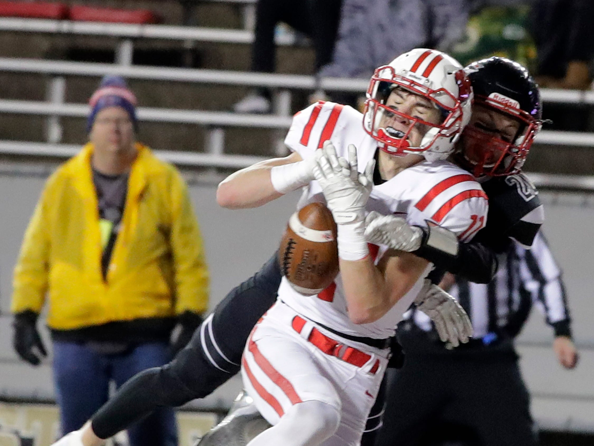 Kimberly's Connor Wnek (11) catches a touchdown pass against Muskego in the WIAA Division 1 championship game at Camp Randall Stadium on Friday, November 16, 2018 in Madison, Wis.