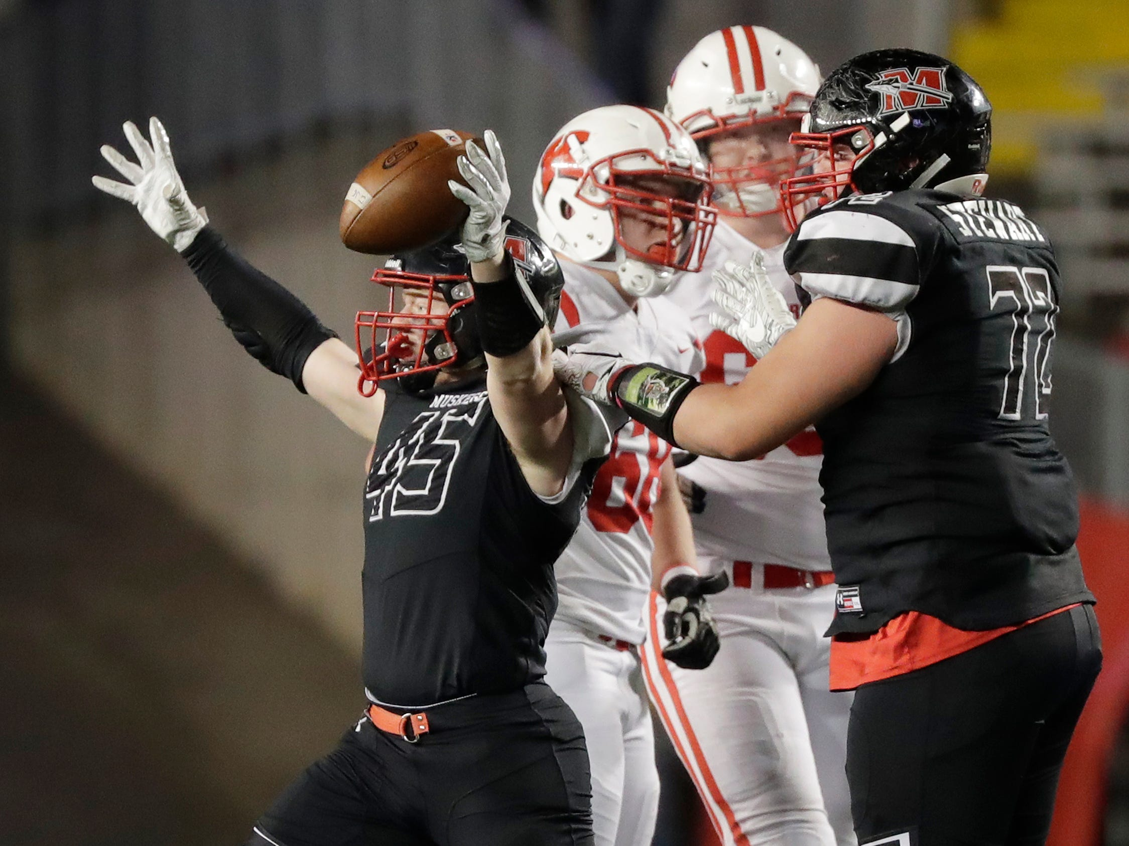 Muskego's Mitch Borkovec (45) reacts after an interception against Kimberly in the WIAA Division 1 championship game at Camp Randall Stadium on Friday, November 16, 2018 in Madison, Wis.