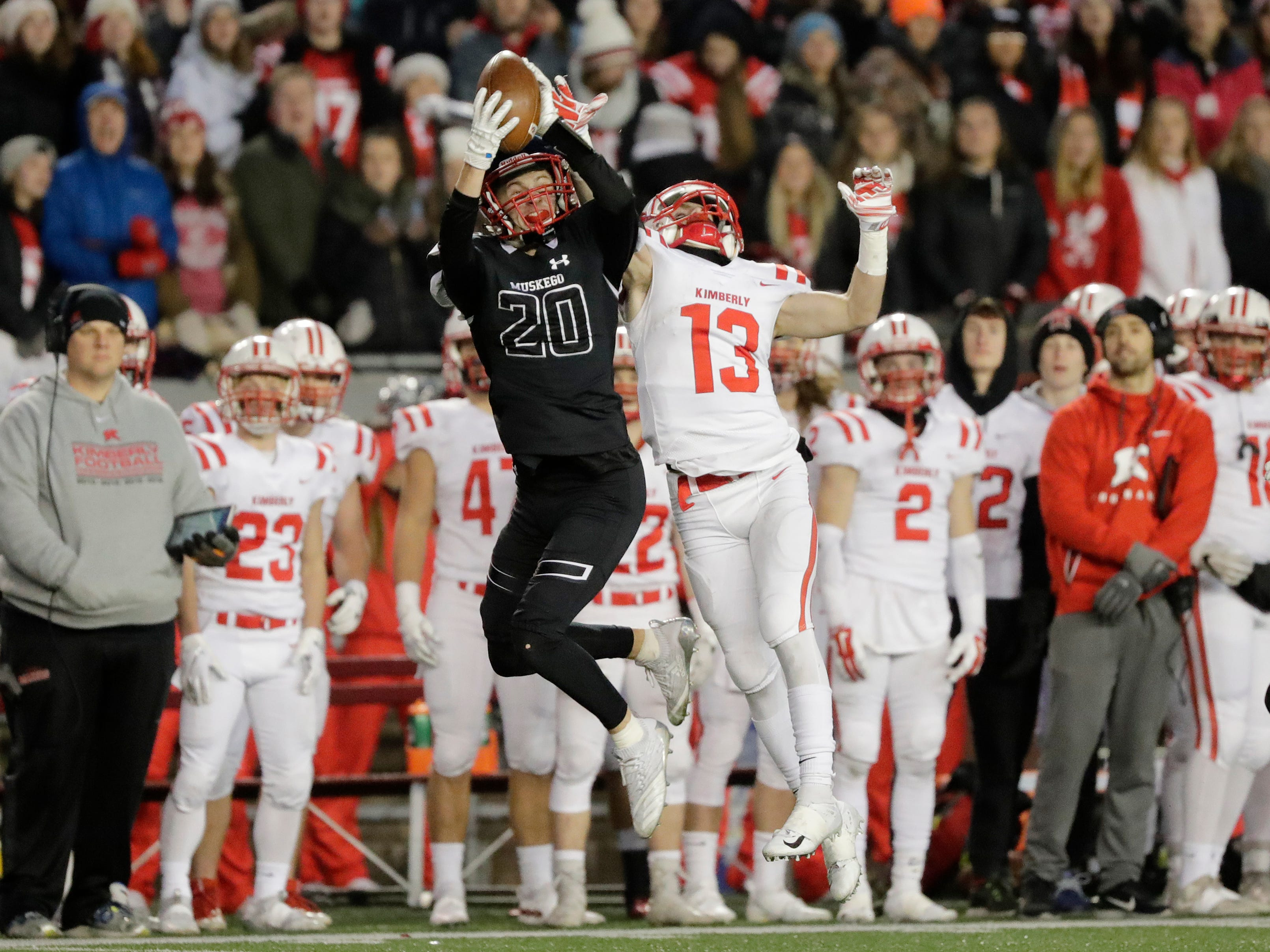 Muskego's Sam Chovanec (20) intercepts a pass intended for Kimberly's Zach Lechnir (13) in the WIAA Division 1 championship game at Camp Randall Stadium on Friday, November 16, 2018 in Madison, Wis.