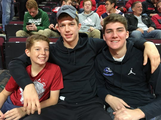 Gill St. Bernard's basketball standout Paul Mulcahy (center), a Rutgers commit, sat behind the Scarlet Knights' bench for the St. John's game.