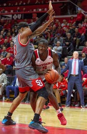 Rutgers #5 Eugene Omoruyi tries to get around St. John's #13 Marvin Clark II.