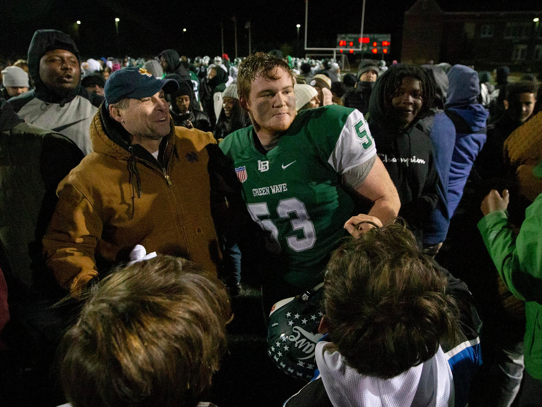 Long Branch's Kevin Cerruti celebrates with the fans. Brick at Long Branch NJSIAA Central Jersey Group IV championship football game.
