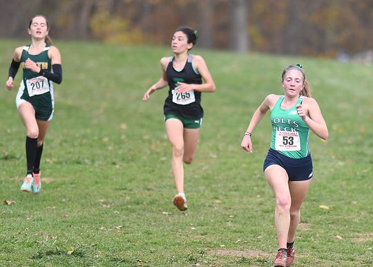Colts Neck's Delia Russo heads to the finish line at the Cross Country Meet of Champions at Holmdel Park