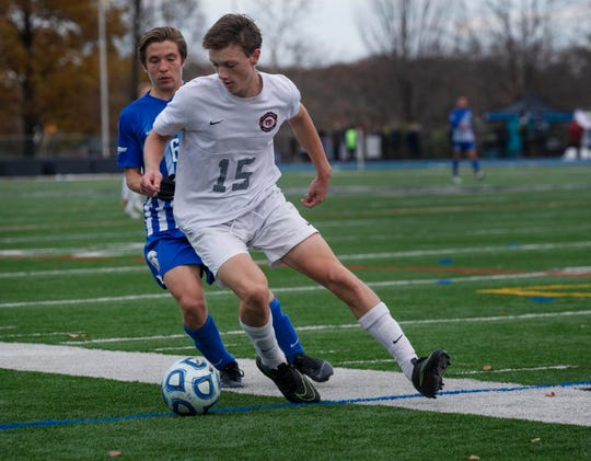 Glen Rock defender Owen Corry (15) makes a play on the ball during the Group 2 state final against Holmdel on Nov. 17, 2018.