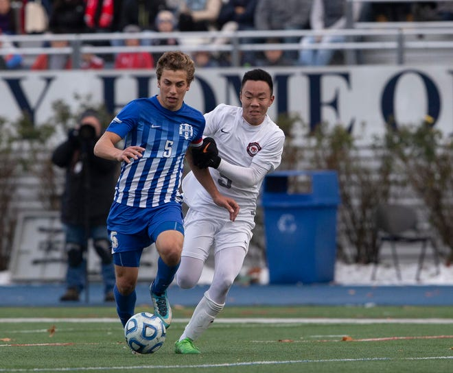 Holmdel's Joe Arena (5) shields the ball from Glen Rock senior Josh Kim during the Group 2 soccer final at Kean University.