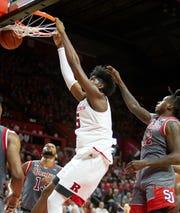Rutgers Myles Johnson dunks vs. St. John's.