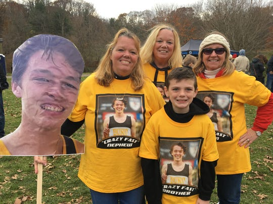 Devin Hart's family cheering section, including 8-year-old brother Owen, wearing shirts with his image.