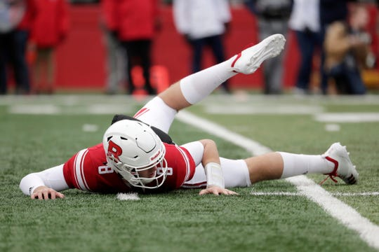 Rutgers quarterback Artur Sitkowski looks on from the turf after being tossed while throwing a pass against Penn State during the first half on Saturday, Nov. 17, 2018, in Piscataway, N.J.