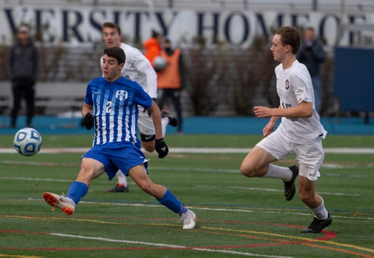 Holmdel's Jack Giamando (2) moves past two Glen Rock defenders in the Group 2 state championship match in Union NJ.