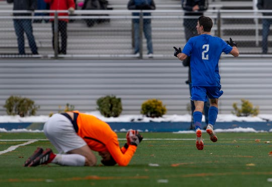 Holmdel's Jack Giamanco celebrates after  putting  in Holmdel's first goal to tie the game 1-1 in first half. Holmdel vs Glen Rock in NJSIAA Boys Group II Soccer final in Union NJ.