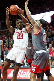 Rutgers Montez Mathis (23) goes up against St. John's Marvin Clark II (13) during the first half of St. John's at Rutgers Men's Basketball on November 16, 2018 at the Rutgers Athletic Center in Piscataway.
