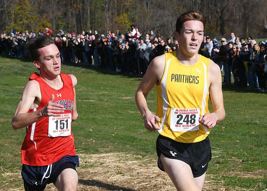 Point Boro's Devin Hart holds off Mendham's Jack Stanley at the finish line.