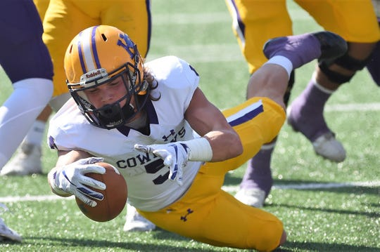 Hardin-Simmons receiver Reese Childress (5) reaches for extra yards in the first round of the NCAA Division III playoffs against Mary Hardin-Baylor at Crusader Stadium in Belton on Saturday, Nov. 17, 2018.