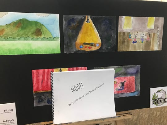 A display shows artwork and a children's book written by an Abilene ISD student and displayed at the National Center for Children's Illustrated Literature on Thursday.